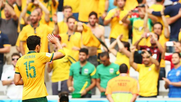 Mile Jedinak salutes Socceroos fans at the World Cup.
