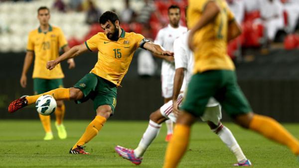 Socceroos skipper Mile Jedinak in action against UAE