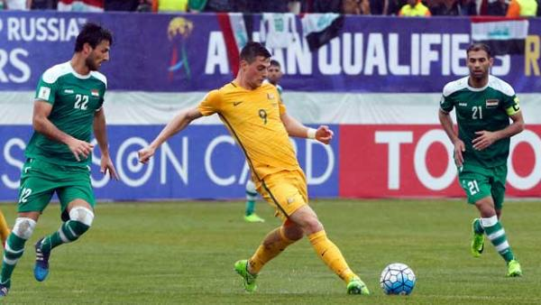Striker Tomi Juric gets a pass away during the 1-1 draw with Iraq in Tehran.