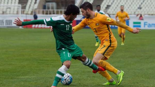 Winger Mat Leckie takes on his Iraqi opponent during the 1-1 draw in Tehran.