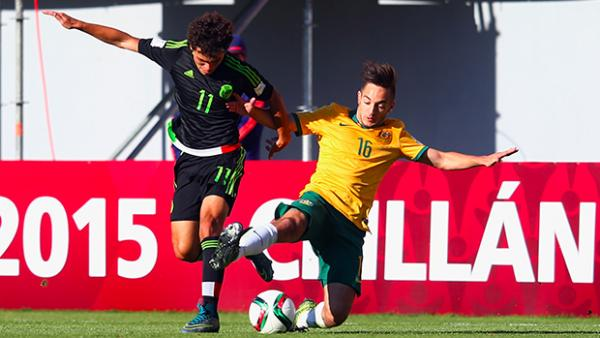 Jonathan Vakirtzis makes a lunging tackle to stop a Mexican attack.
