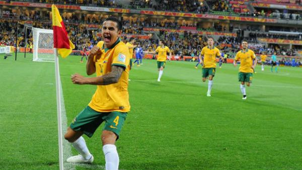 Tim Cahill performs his trademark goal celebration after scoring against Kuwait.