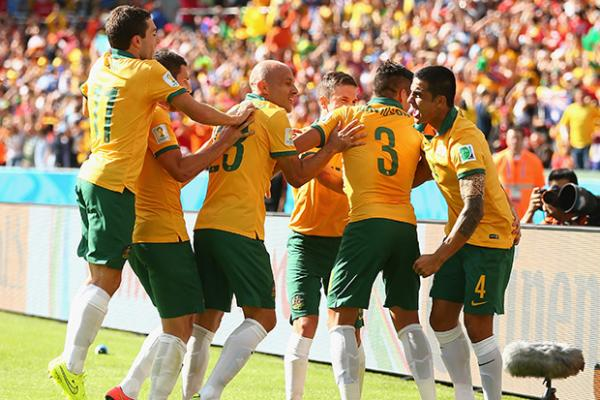Socceroo Tim Cahill celebrates his incredible strike against the Netherlands with teammates.