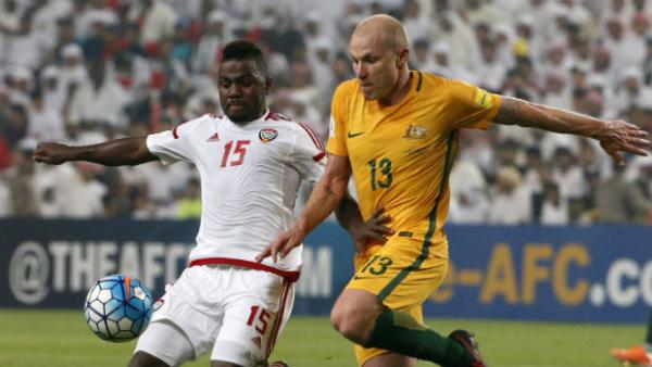 Midfielder Aaron Mooy challenges for the ball against UAE.