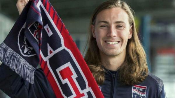 Olyroo Jackson Irvine shows his Ross County FC colours.