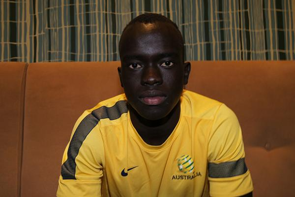 Mabil gets in the green and gold groove
