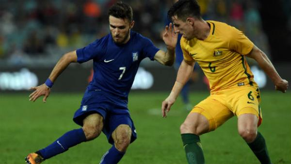 Caltex Socceroos defender Milos Degenek shadows Greece attacker Loannis Gianniotas.
