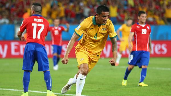 Socceroos striker Tim Cahill celebrates after scoring against Chile.