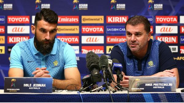 Caltex Socceroos captain Mile Jedinak and coach Ange Postecoglou at Wednesday's press conference.