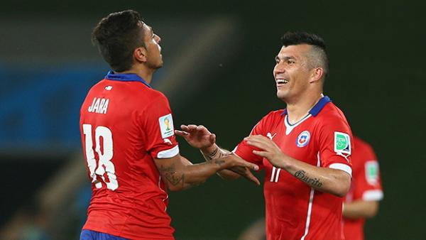 Chile's Gonzalo Jara and Gary Medel celebrate after defeating the Socceroos.
