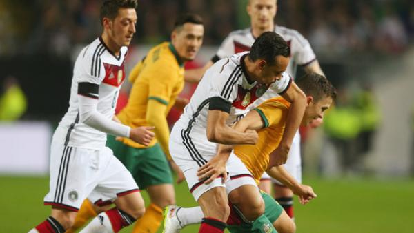 Socceroo midfielder Matt McKay fights for the ball against Germany.