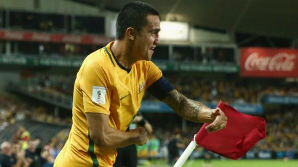 Tim Cahill performs his trademark goal celebration after scoring against Jordan on Tuesday night.