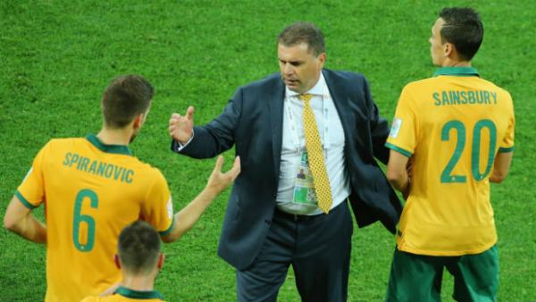 Socceroos coach Ange Postecoglu congratulates his players at full-time against Kuwait.