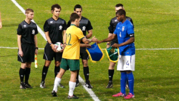 The Young Socceroos and Brazil U-20's captains before kick-off at WIN Stadium.