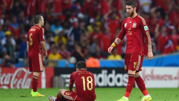 Spanish players look on following their World Cup loss to Chile.