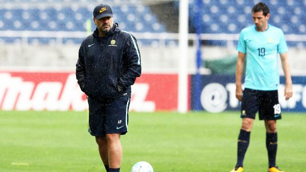 Ange Postecoglou looks on during a Caltex Socceroos training session in Japan.