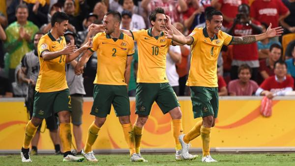 Socceroos players celebrate one of Tim Cahill's goals against China PR.