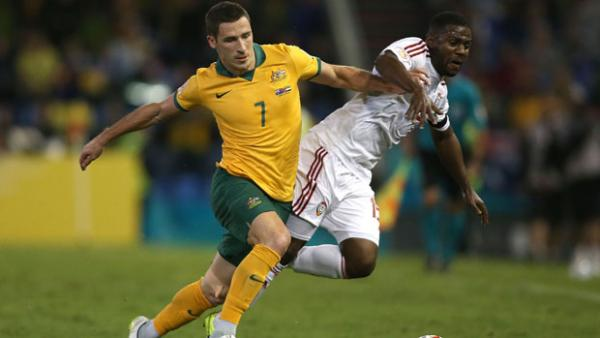 Socceroos flyer Mat Leckie challenges for the ball with UAE's Ismail Al Hammadi during the 2015 Asian Cup.