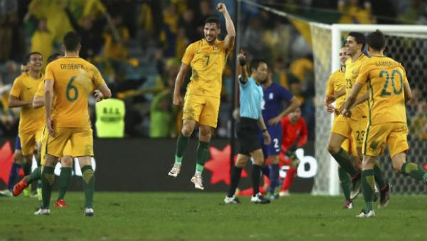 Caltex Socceroos forward Mathew Leckie celebrates scoring against Greece.