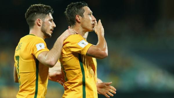 Mark Milligan celebrates a goal in World Cup qualifying against Tajikistan.