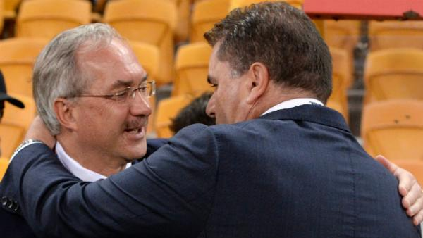 Ulrich Stielike and Ange Postecoglou wish each other good luck before kick-off.